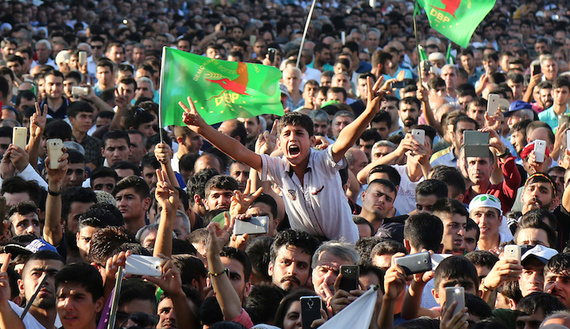 People gather on a main square of Kurdish-dominated city of Diyarbakir during the